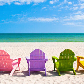 Adirondack Beach Chairs on a Sunny Vacation Beach